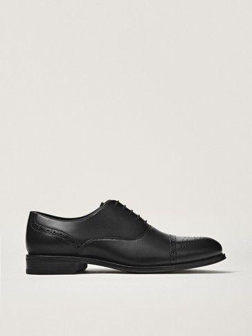 Black leather smart brogues