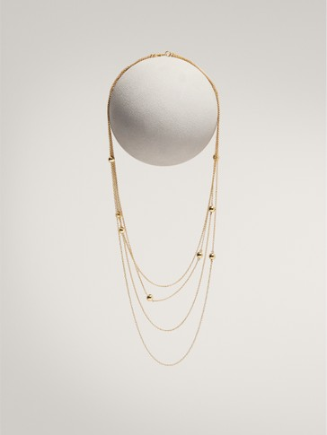 MULTI-STRAND NECKLACE WITH GOLD-PLATED BEADS