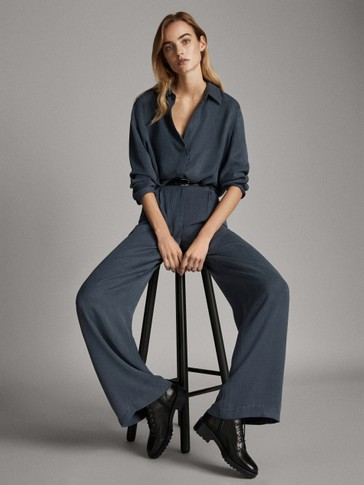 Loose-fitting trousers with raised jacquard