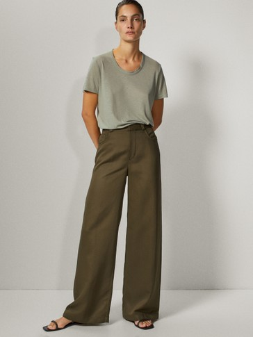 WIDE-LEG TROUSERS WITH ROUNDED POCKETS