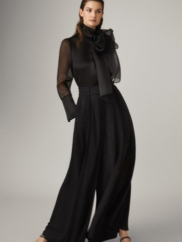 BLACK PLEATED WIDE-LEG TROUSERS