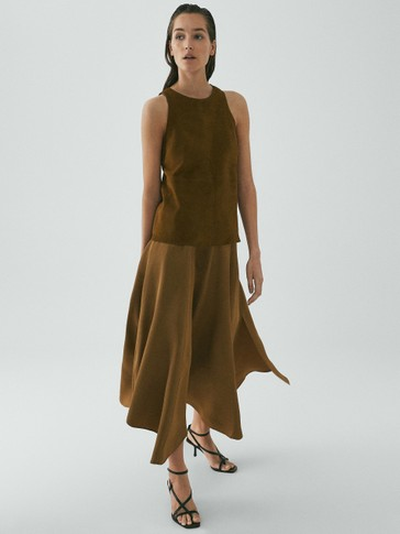 LIMITED EDITION LOOSE-FITTING SKIRT WITH ASYMMETRIC HEM