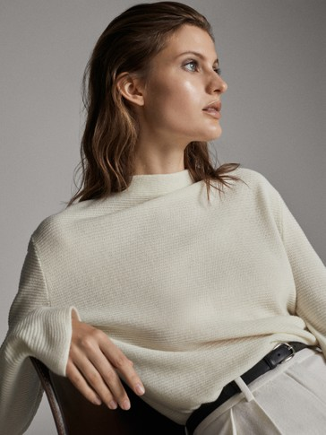 High neck wool ribbed sweater