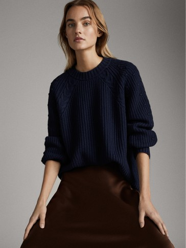 High neck purl-knit wool sweater