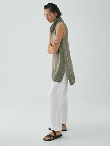 LIMITED EDITION SLEEVELESS CAPE SWEATER WITH HIGH NECK