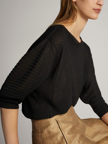 TEXTURED CAPE SWEATER WITH BATWING SLEEVES