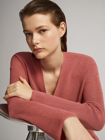 PURL KNIT SWEATER WITH DECREASE STITCH DETAIL