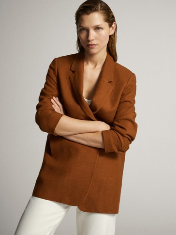 Double-breasted blazer with decorative buttons
