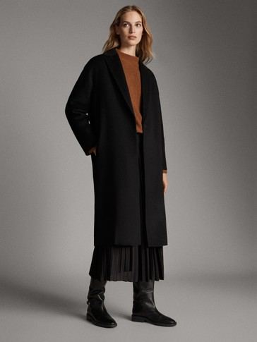 Hand-tailored black quilted wool coat