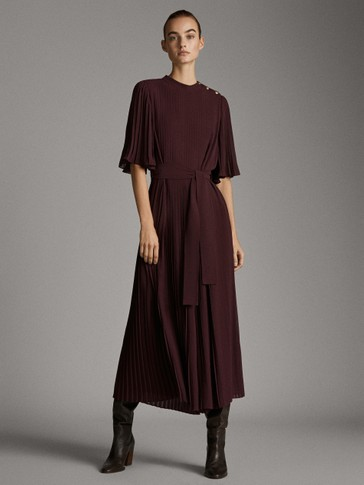 Pleated jumpsuit with belt
