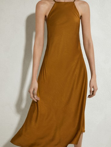 Camisole dress featuring an asymmetric hem
