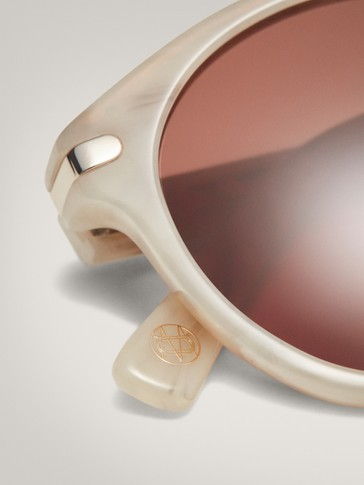 Round ecru sunglasses with metal bridge