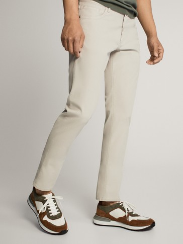SLIM FIT TEXTURED DENIM-EFFECT TROUSERS