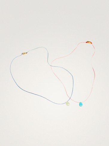 PACK OF STRING NECKLACES WITH COLOURED STONES