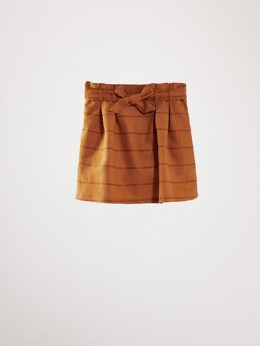 تنورة مربعات حزام