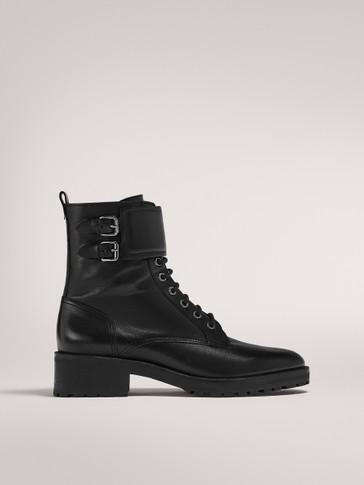 حذاء للكاحل مع مشابك بأحزمة