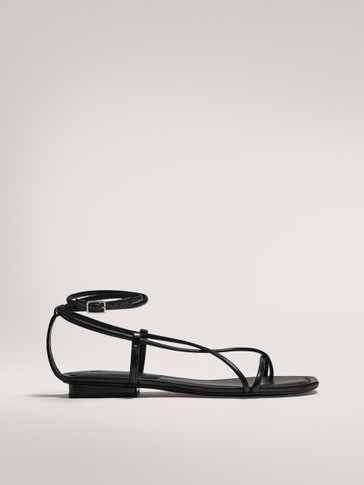 FLAT SANDALS WITH MULTIPLE STRAPS