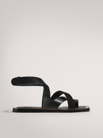 LIMITED EDITION BLACK FLAT SANDALS