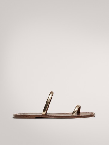 DOUBLE-STRAP FLAT GOLDEN SANDALS