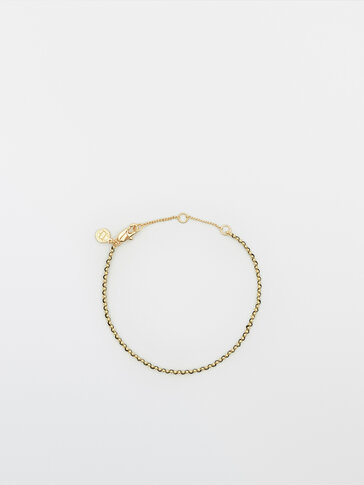 Gold-plated coin and coloured thread bracelet