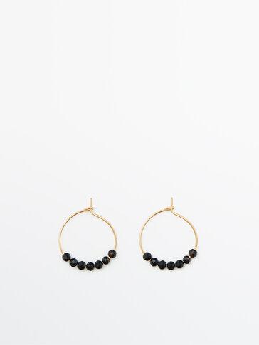 Позолоченные серьги-кольца с черными камнями