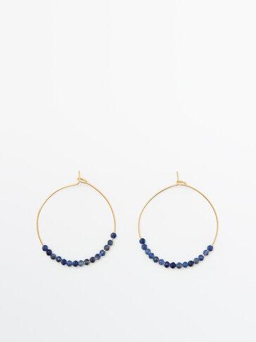 Позолоченные серьги-кольца с синими камнями