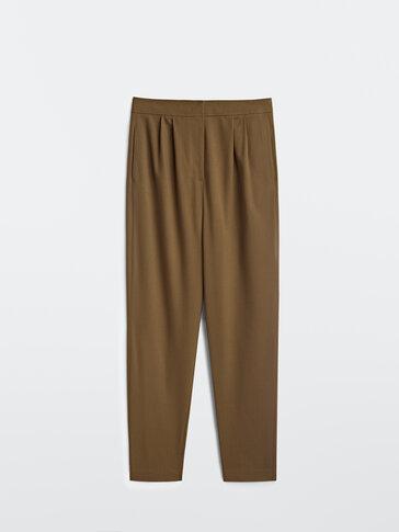 Pantalón tiro alto pinzas