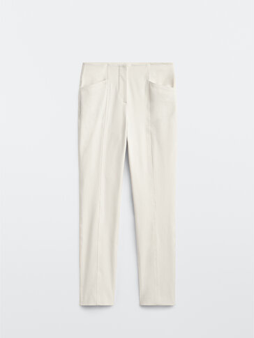 Elastic trousers with pockets