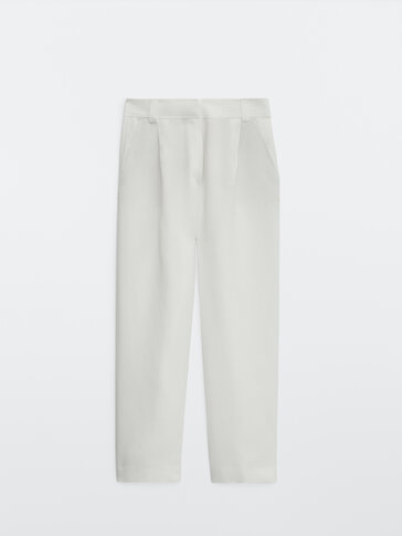 Straight fit trousers with topstitching at the waist