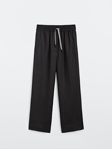 Flowing trousers with elastic waistband