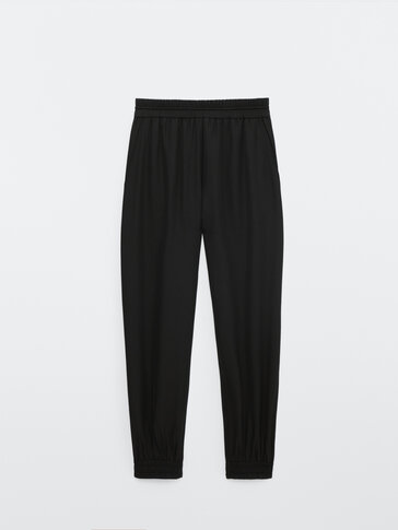 Flowing jogging fit trousers with elastic hems