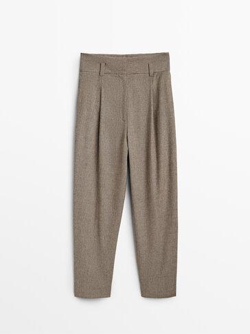 Kalhoty se záševky a drobnou kostkou