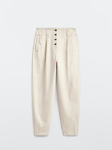 Slouchy trousers with button detail