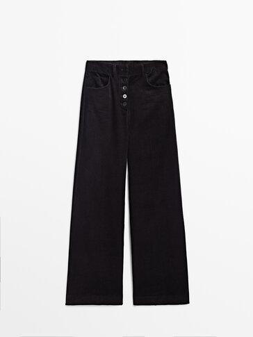 Široke hlače od rebrastog baršuna s gumbima