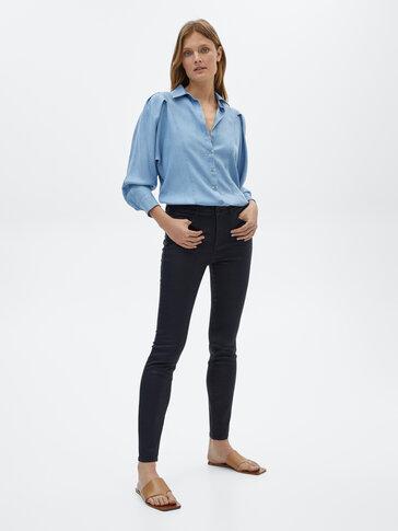 Pantaloni cauciucați mid rise skinny