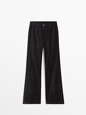 Pantaloni evazați din catifea cu talie înaltă