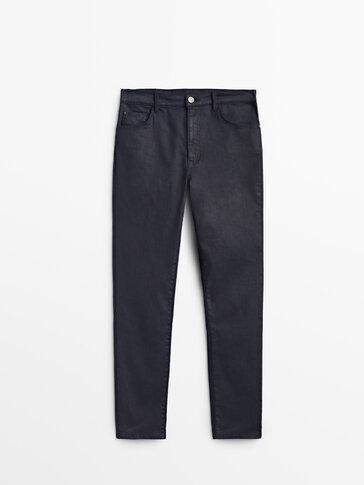 High-waist coated trousers
