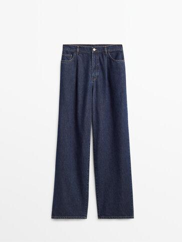 กางเกงยีนส์ขากว้างตีเกล็ด