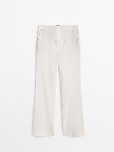 Расклешенные брюки из крепа