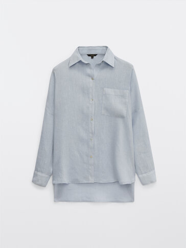 Washed linen shirt with rolled-up sleeves