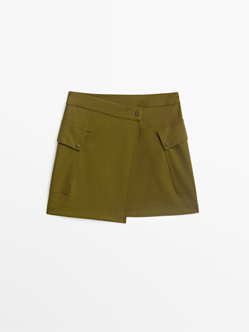 Asymmetric mini skirt with patch pockets