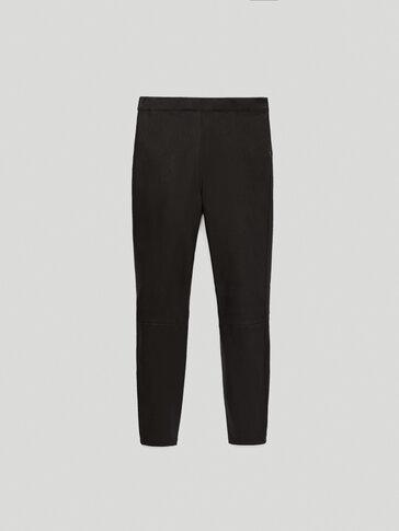 Schwarze Leder-Leggings