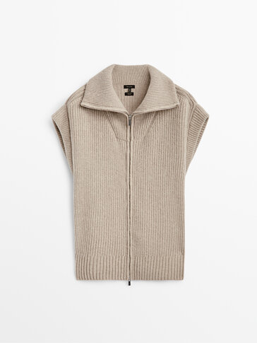 Knitted vest with a high neck and zip