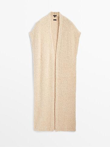 Long bouclé knit vest