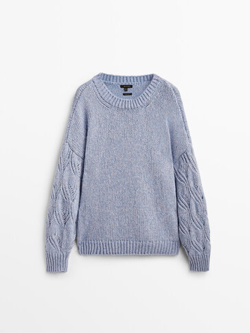 Knit sweater with open knit sleeves