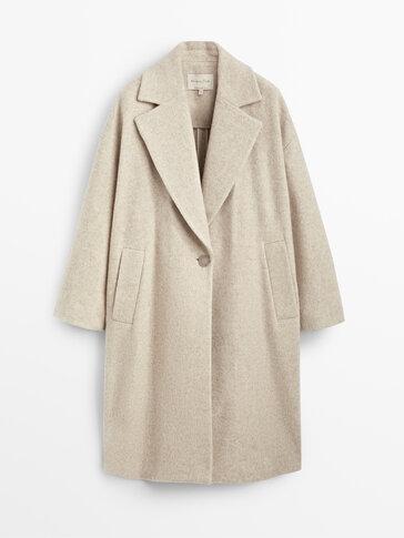 Кремаво вълнено палто с едно копче