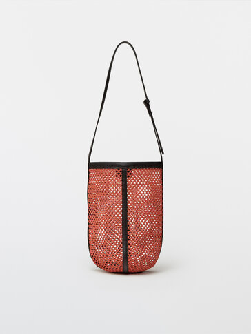 Bucket bag with leather details