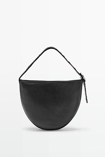 Half moon bag with braided leather strap