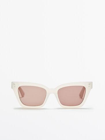 Sunglasses with transparent cream frame