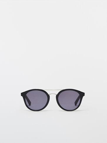Round sunglasses with metal bridge